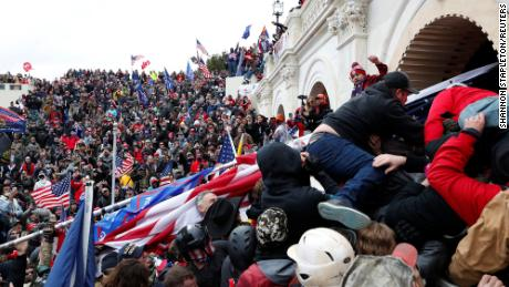 Pro-Trump insurgents storm into the US Capitol during clashes with police, during an insurrection to contest the certification of the 2020 US presidential election results by the US Congress in Washington on January 6.