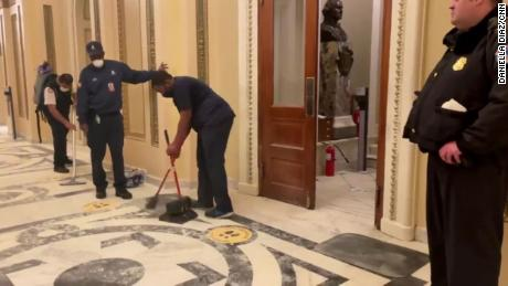 The jarring, revealing video of Black men cleaning up the Capitol