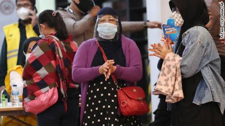 Relatives of passengers arrive at a crisis center set up at Soekarno-Hatta International Airport on Saturday.