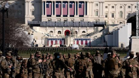 National Guard members stand outside the US Capitol in Washington on Thursday.