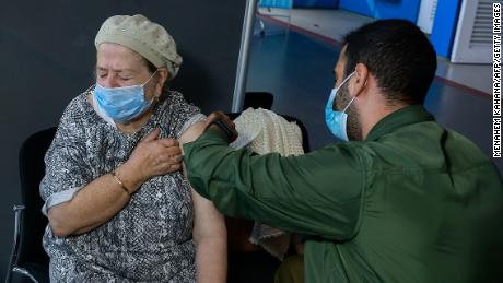 A health care worker administers a vaccine in Jerusalem, on January 6.