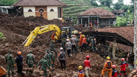 Rescue teams search for victims buried by the landslides in Cihanjuang Village, West Java.