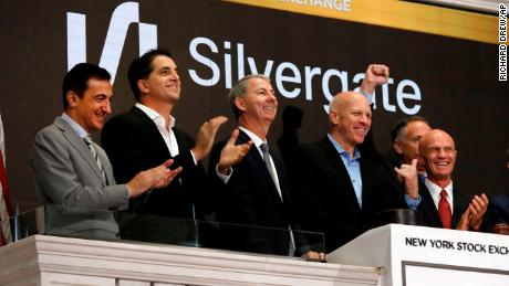 Slivergate CEO Alan Lane, second from right, is applauded as he rings the New York Stock Exchange opening bell before his bank's IPO begins trading, Thursday, Nov. 7, 2019. (AP Photo/Richard Drew)