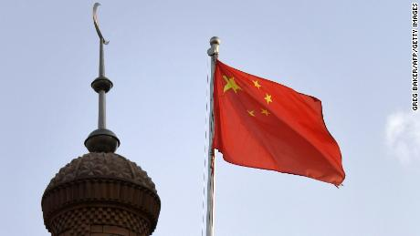 The Chinese flag flies over the Juma mosque in the restored old city area of Kashgar, in China's western Xinjiang region, on June 4, 2019.