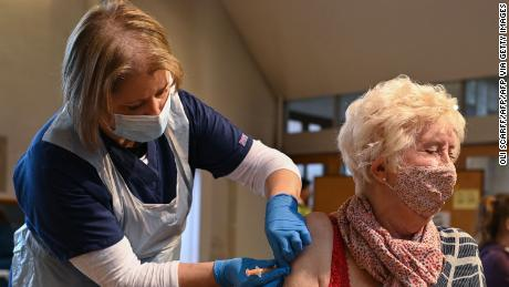 A member of the public is inoculated at a temporary vaccination center in Sheffield, northern England, on January 23.
