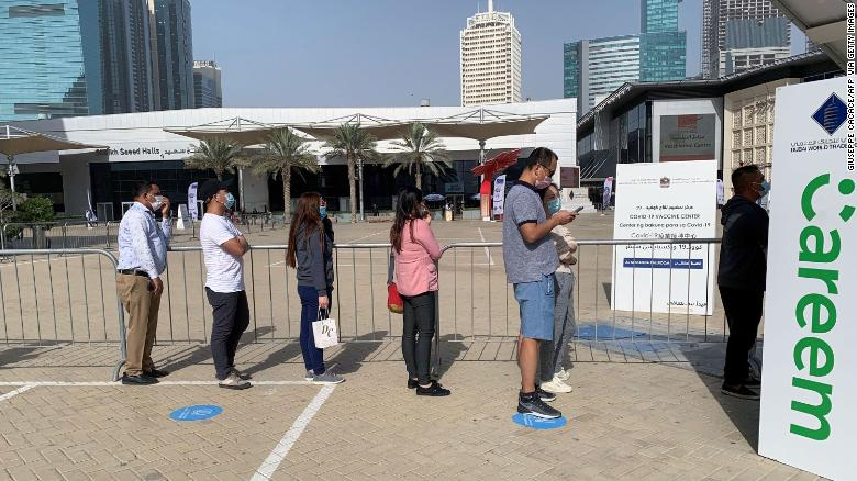 People line up at a vaccination facility in Dubai's financial center district on January 24, 2021.