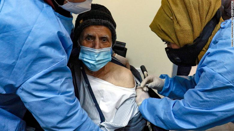 An elderly man receives a dose of the Sinopharm vaccine in Amman, Jordan, in January.