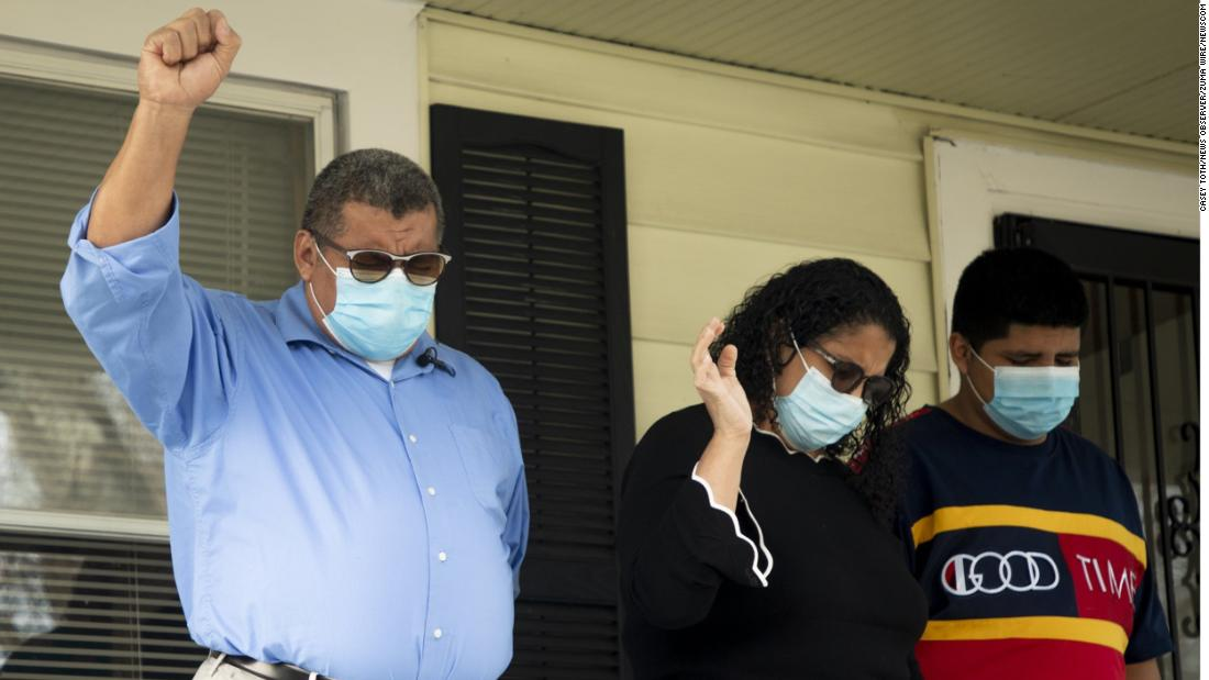 José Chicas prays with his family as he leaves sanctuary. For more than three years he lived on the grounds of Saint Johns Missionary Baptist Church in Durham, North Carolina.