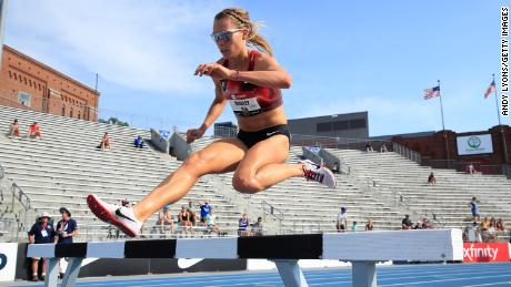 Quigley clears a hurdle during the 2019 USATF outdoor championships in Des Moines, Iowa.