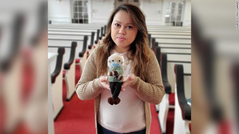 Chávez holds up the Bernie Sanders doll she crocheted.