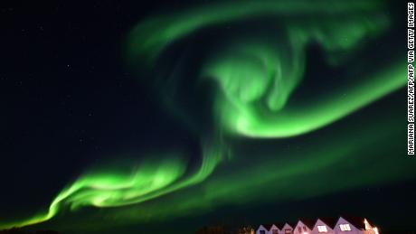 The aurora borealis lights up the night sky in Iceland.