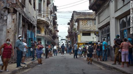 People line up to buy food in Havana, on February 2, 2021, as Covid-19 cases surge in the island nation.