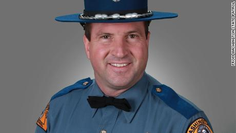 A Washington state trooper was killed in an avalanche while snowmobiling, officials say
