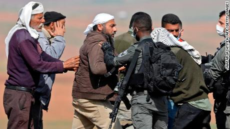 Residents clash with Israeli security forces as soldiers demolish Bedouin tents and structures, east of the village of Tubas, in the West Bank, on February 8, 2021.