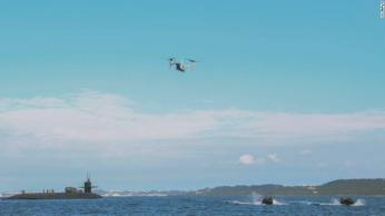 A US Marine Corps MV-22B Osprey and Marines in a small watercraft conduct an exercise with the guided-missile submarine USS Ohio off the coast of Okinawa, Japan, earlier this month.