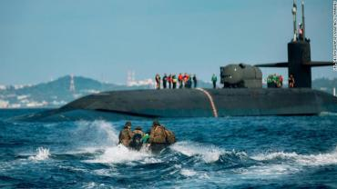 US Marines utilize combat rubber raiding crafts to approach the USS Ohio during an integration exercise off the coast of Okinawa, Japan, this month.