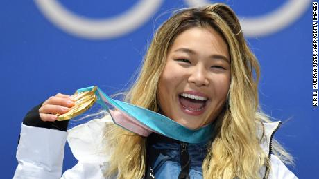 USA gold medalist Chloe Kim is on the podium at the 2018 Winter Olympic Games.