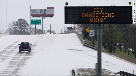 A truck braves the frozen roads in Houston on Monday, February 15.