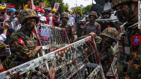 The protesters held banners and raised slogans while military troops from Myanmar's 77th Light Infantry Division halted the barrage in Myanmar on 15 February 2021.