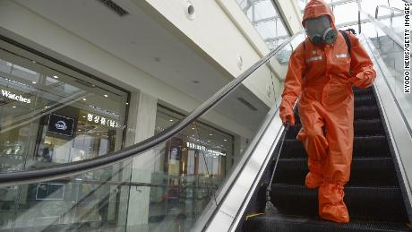 A worker sprays disinfectant at a department store in Pyongyang on August 7, 2020, amid concerns over the coronavirus.
