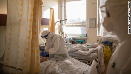A health care worker takes care of a patient in the Covid-19 ward at Hospital Karvina-Raj on January 11, 2021 in Karvina, Czech Republic.