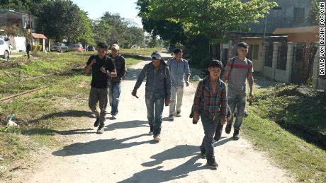 Carlos and brother Wilfredo continue their journey north with a group.