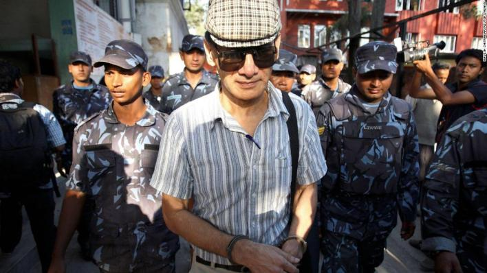 Sobhraj leaves Kathmandu district court after a hearing on May 31, 2011.