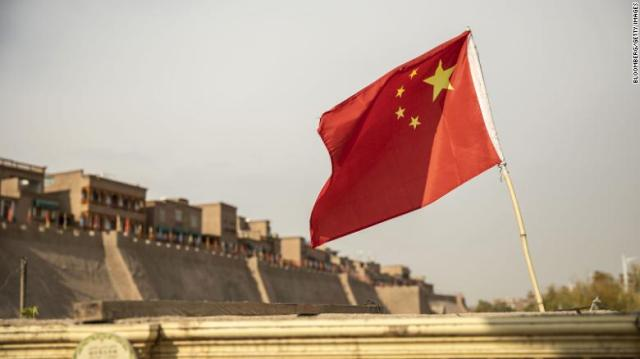 A Chinese flag flies outside the east gate of the Old City in Kashgar, Xinjiang, on November 8, 2018.