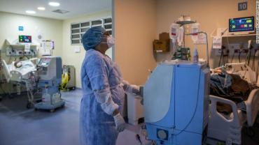 A health worker cares for a COVID-19 patient at an Intensive Care Unit (ICU) of the Ronaldo Gazolla Public Municipal Hospital in Rio de Janeiro, Brazil, on March 5, 2021.