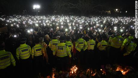 Police officers form a cordon at the Everard vigil in London on March 13.