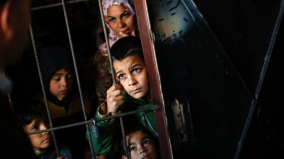 Syrian children wait as doctors perform medical checkups at a refugee center in Sofia, Bulgaria, on October 26, 2013.