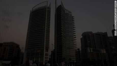 Buildings loom in the dark during a power outage in Beirut on July 5, 2020.