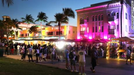 Miami Beach officers shoot pepper balls into spring break crowds to enforce emergency curfew
