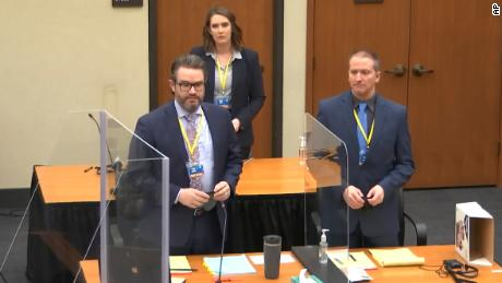 In this still from the video, defense attorney Eric Nelson, left, former Minneapolis cop Derek Chauvin, right, and Nelson's assistant Amy Voss, back, appear to jurors on Monday, April 22. March 2021 at the Hennepin.  Minneapolis County Courthouse.