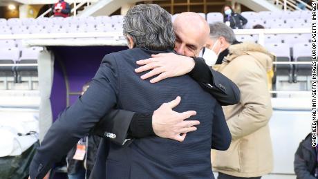 AC Milan coach Stefano Pioli hugs Cesare Prandelli before Sunday's clash, Prandelli's last in charge of Fiorentina.