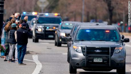A procession of emergency vehicles leads a hearse carrying the body of Officer Eric Talley in Boulder on Wednesday.