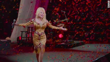 """The legendary singer is shown in a scene from """"Dolly Parton: A MusicCares Tribute"""" on Netflix."""