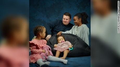 Frank Lundt, his wife, Mary Mithika, and their daughters, Ayah, 1, (seated) and Amira, 2.