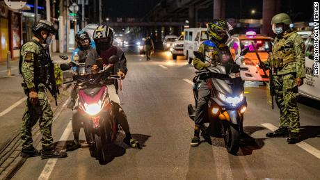 The Philippine National Police has deployed thousands of officers to help enforce the lockdown rules imposed on Manila and surrounding provinces.