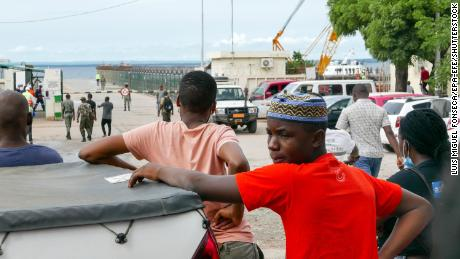 People in Pemba, Mozambique await the arrival of more ships from Palma as people flee attacks by rebel groups on March 29.