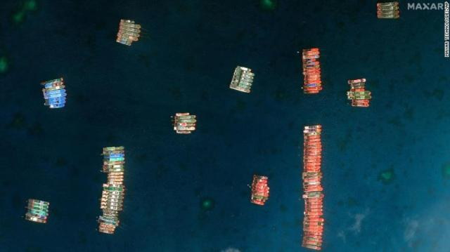 This satellite image provided by Maxar Technologies shows Chinese vessels in the Whitsun Reef located in the disputed South China Sea. Tuesday, March 23, 2021.