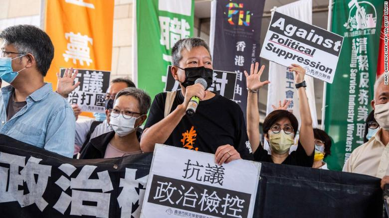 Pro-democracy activist Lee Cheuk-yan (C) speaks to the media outside West Kowloon Court in Hong Kong on April 1, 2021.