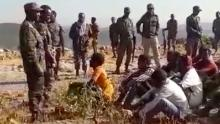 Footage obtained by CNN shows soldiers rounding up dozens of young men on a clifftop and checking if they're armed.