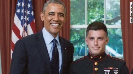 Trevor Reed who is being held in Russia, pictured with former President Barack Obama.