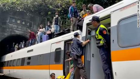 Passengers are helped out of the train in Hulien County, Taiwan on 2 April.