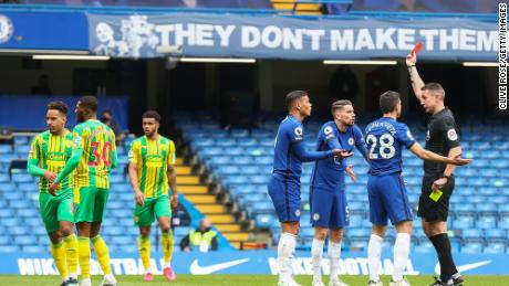 Thiago Silva of Chelsea and teammates Jorginho and Cesar Azpilicueta argue with match referee David Coote after the Brazilian is shown a red card during the Premier League match against West Bromwich Albion at Stamford Bridge.