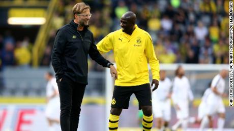 Otto Addo speaks with Borussia Dortmund's former coach Jurgen Klopp.