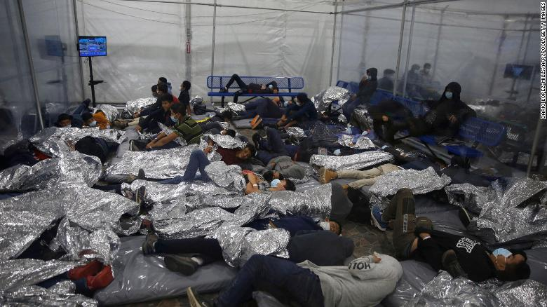 Young children rest inside a pod at the Donna Department of Homeland Security holding facility, the main detention center for unaccompanied children in the Rio Grande Valley run by the Customs and Border Patrol, in Donna, Texas on March 30, 2021.