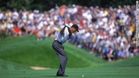 Woods starts to swing during the PGA Championship.