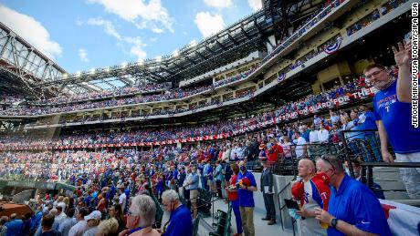 A view of the crowd and the fans and the stands during the playing of the Canadian and USA national anthems before the game between the Texas Rangers and the Toronto Blue Jays at Globe Life Field.